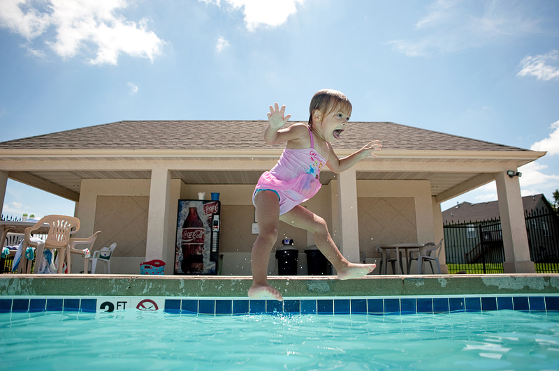 Lia jumping in the pool.
