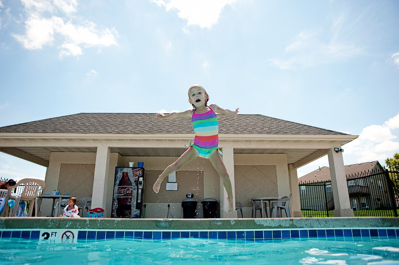 Ava jumping in the pool.