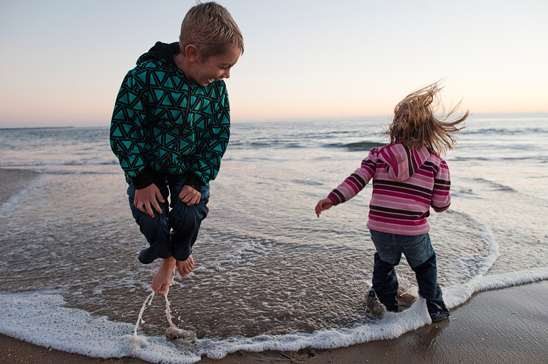 Kids playing in the ocean.