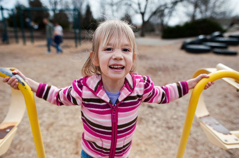 Girl playing at Cosmo Park in Columbia Missouri.