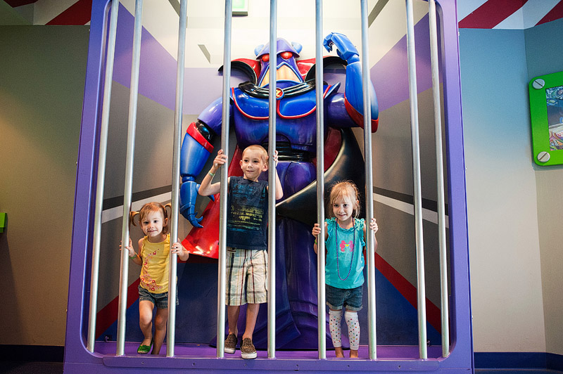 Kids posing with Zurg at Disney World Magic Kingdom.