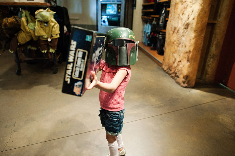 Girl with Boba Fett helmet and Star Wards gun.