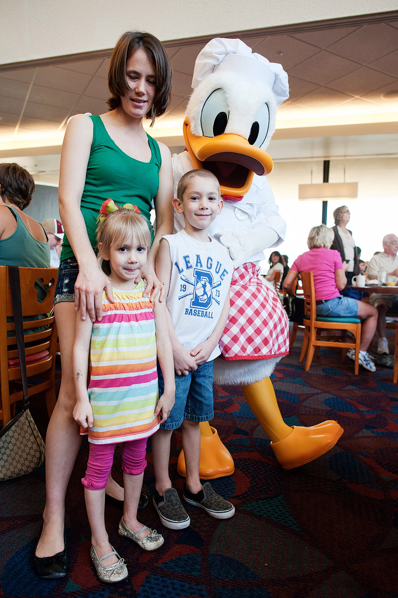 Family with Donald Duck at Disney World.