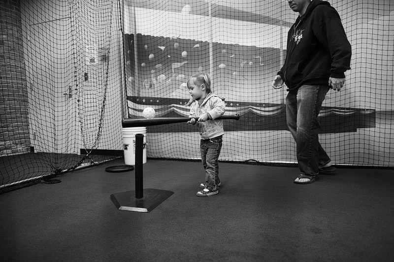 Girl playing in kids area of Louisville Slugger museum.