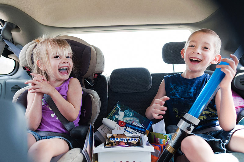 Kids laughing in the back seat.
