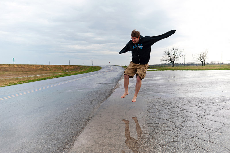 Man jumping in puddles.