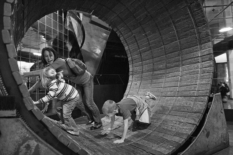 Mom and kids in hamster wheel.