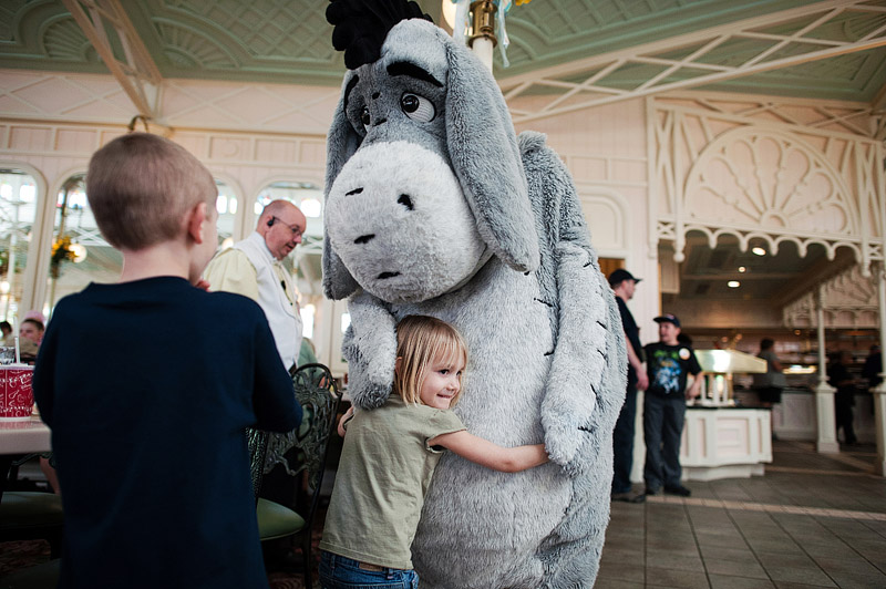 Girl hugging Eeyore at Crystal Palace.