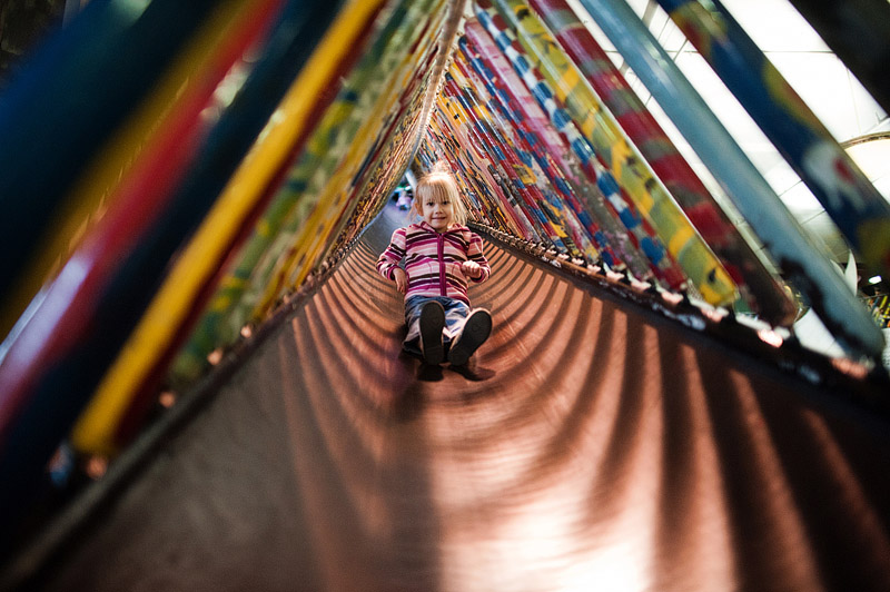 Girl on monster slide at City Museum