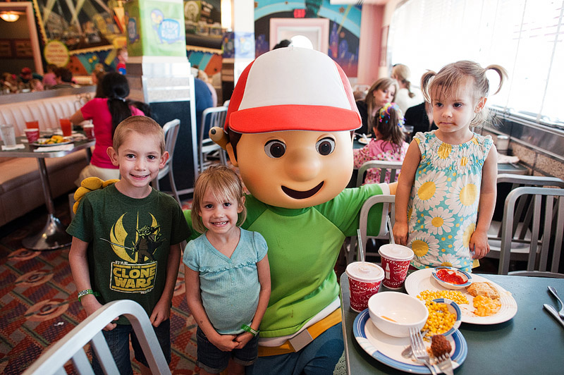 Kids posing with Handy Manny at Hollywood Studios in Orlando, Florida.