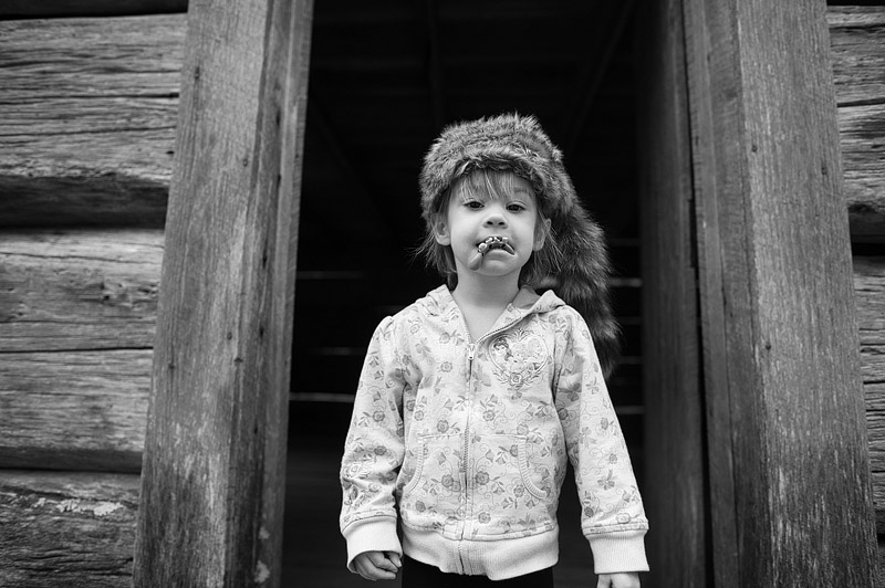 Toddler with coonskin hat and hillbilly teeth in the Great Smoky Mountain National Park.