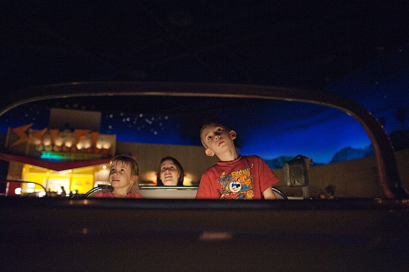 Family eating in a car at the Sci Fi Drive in Diner at Hollywood Studios