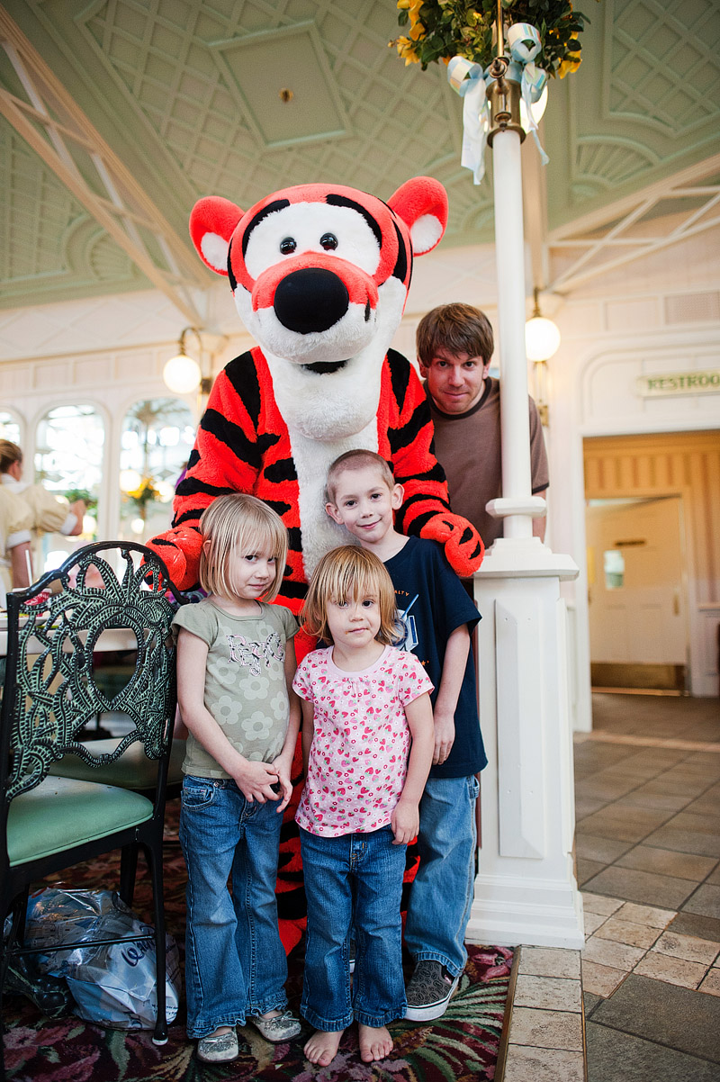 Family posing with Tigger at Disney World's Crystal Palace.