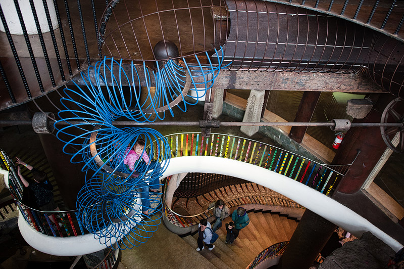 Toddler in blue tunnel at City Museum.