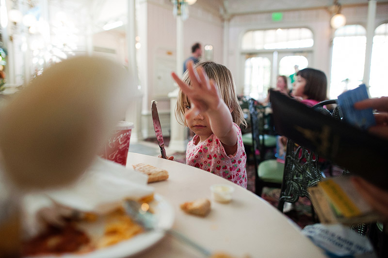 Toddler throwing roll at lunch at Disney World.