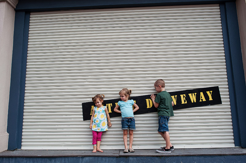 Kids in front of a garage door at Hollywood Studios.