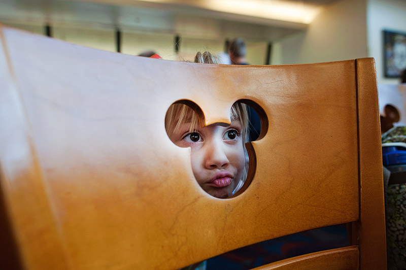 Funny face through a Mickey Mouse chair.