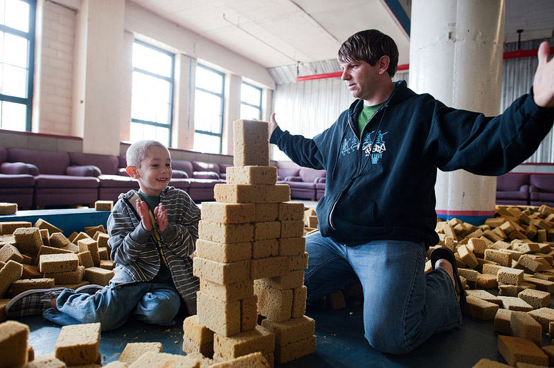 Dad and son building sponge tower at City Museum.