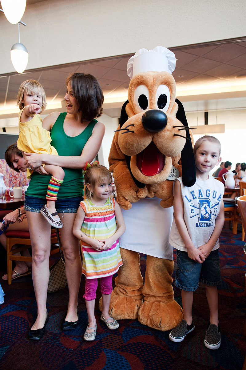 Family posing with Pluto.