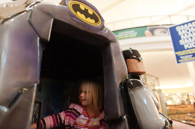 Girl on a Batman ride at Independence Center.