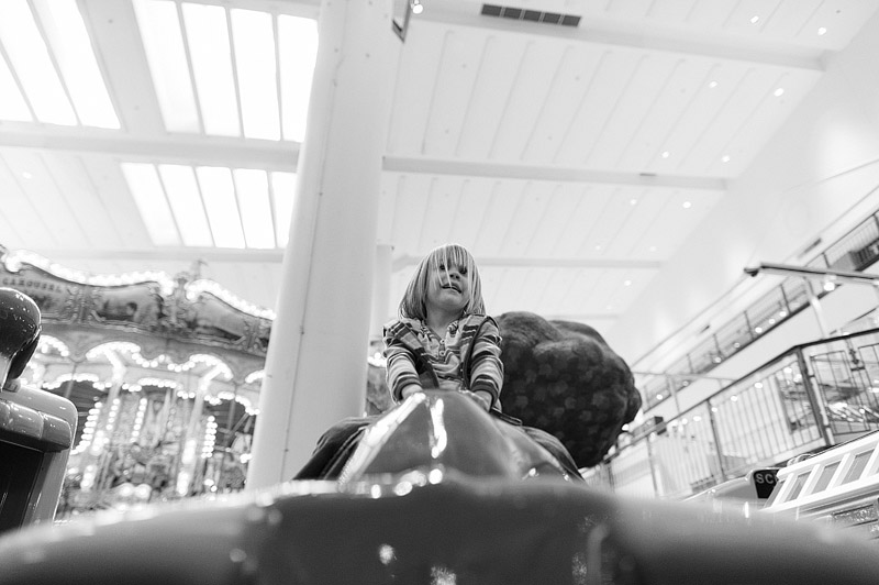 Girl riding rides on a playground.
