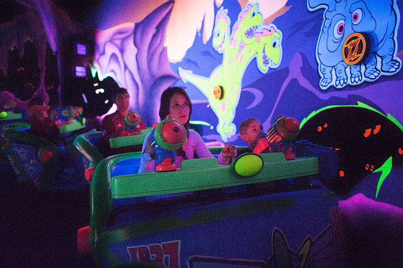 Mom and son on Buzz Lightyear's Space Ranger Spin ride.