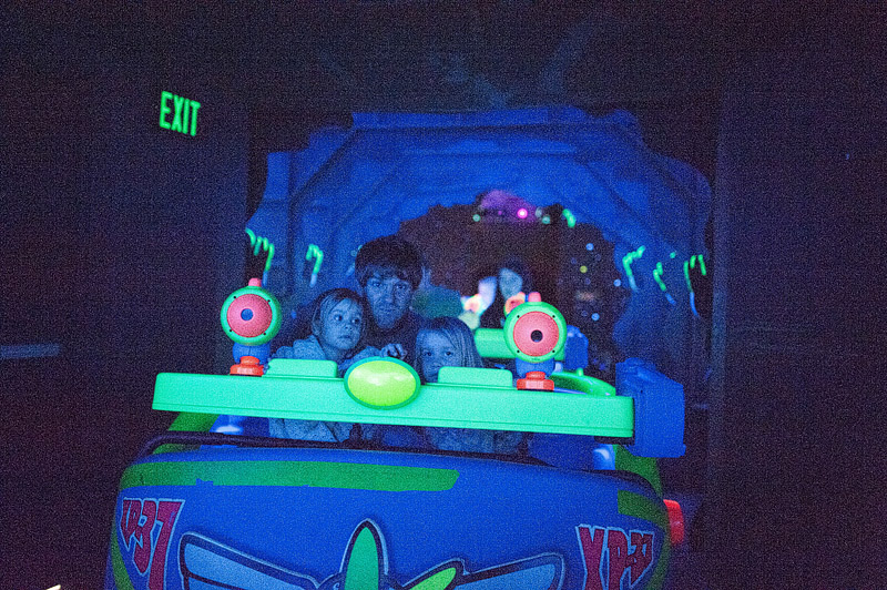 Dad and girls on Buzz Lightyear Space Ranger Spin.