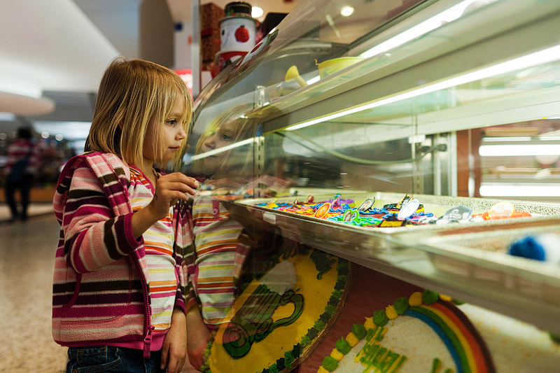 Girl picking out her cookie at the mall.