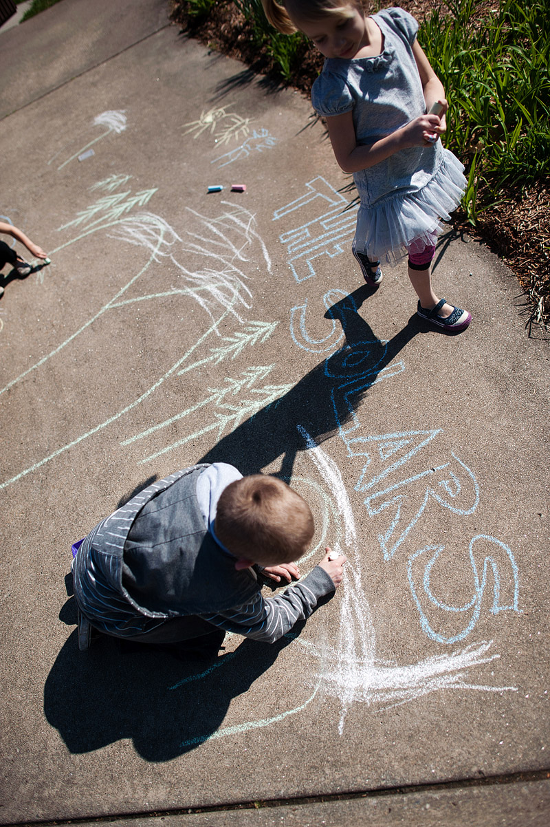 Kids chalk drawing the Great Smoky Mountains at a random rest stop.