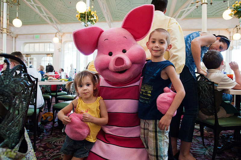 Kids with Piglet at Disney World.