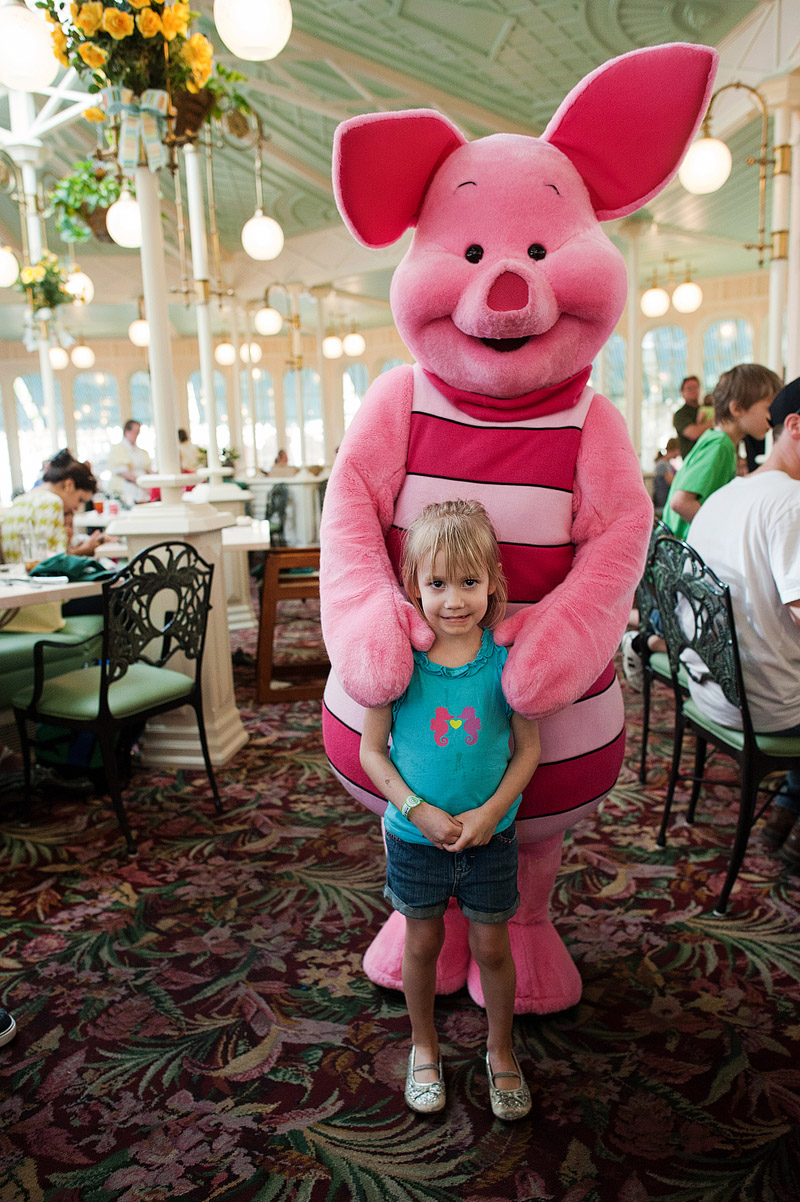 Girl with Piglet at Magic Kingdom.