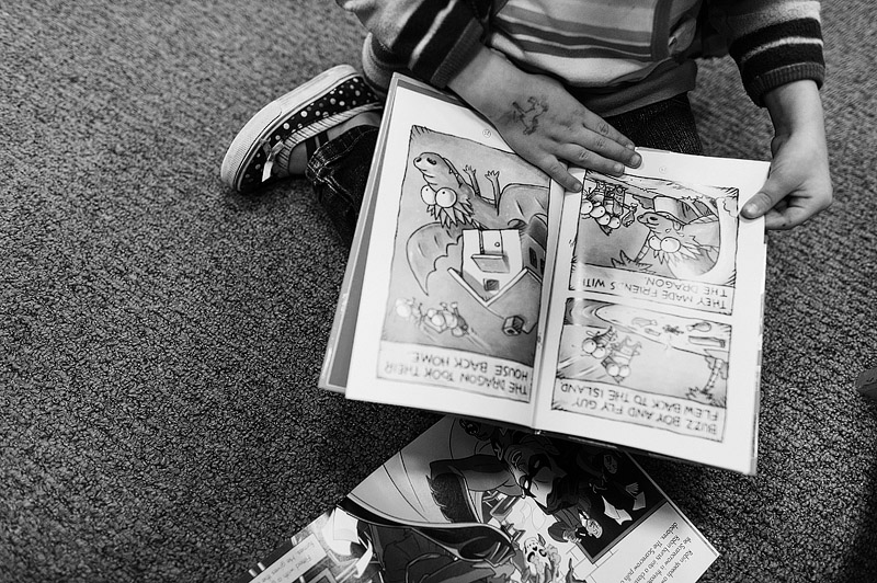 Little girl reading a Fly Guy book.