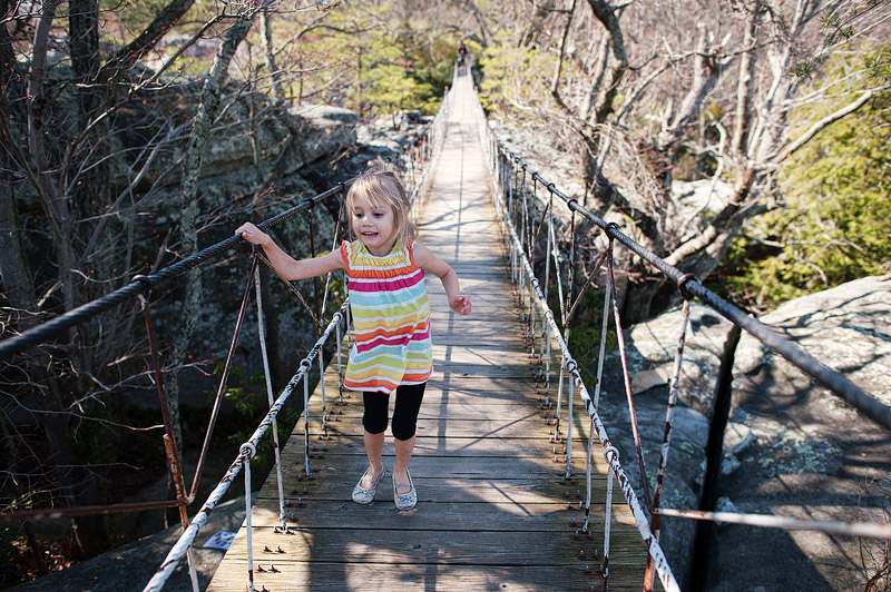 Girl on swing bridge at Rock City.
