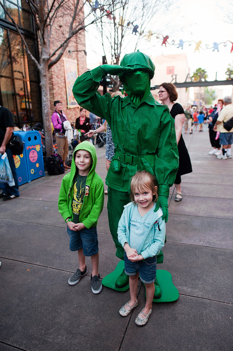 Kids posing with army man from Toy Story.
