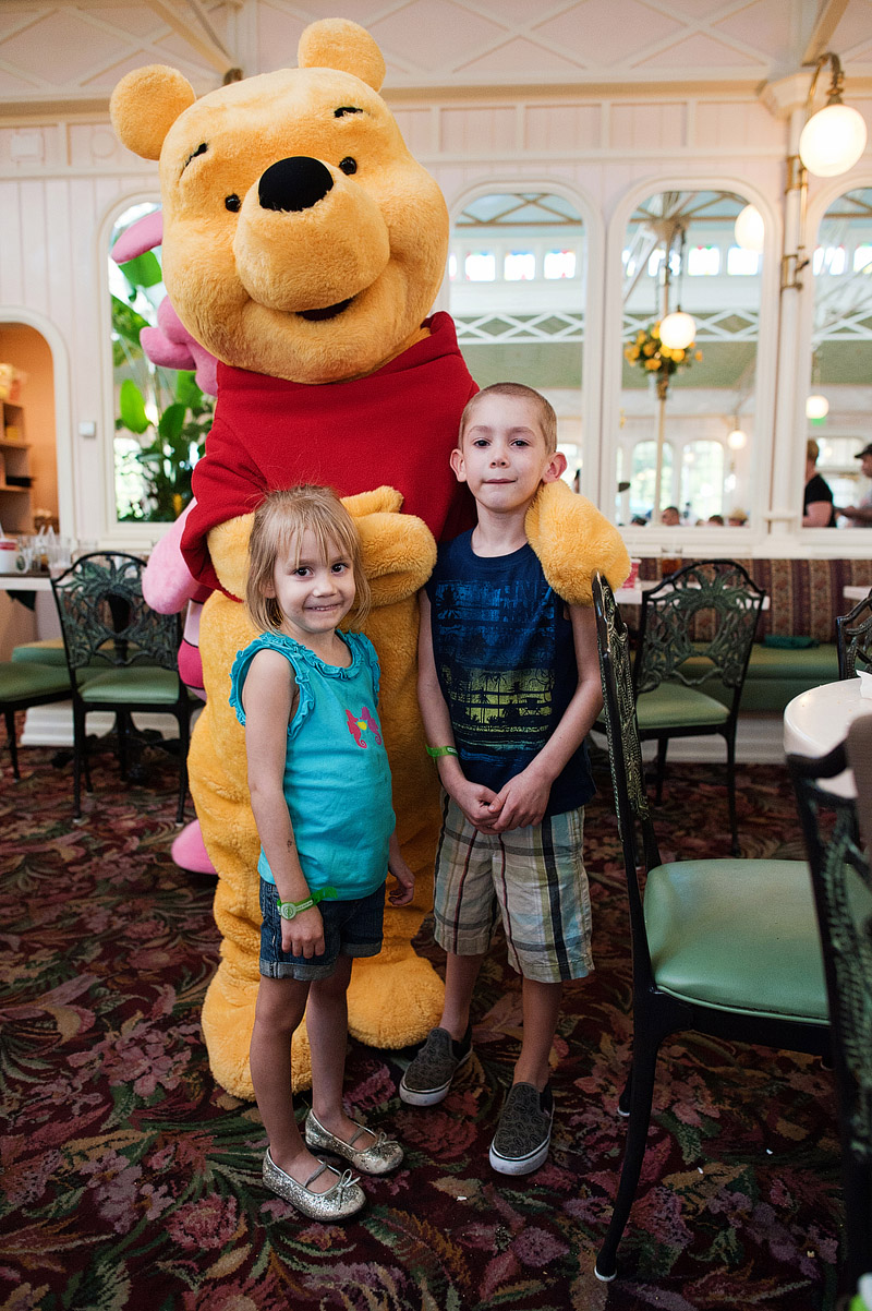 Kids posing with Winnie the Pooh at Crystal Palace.