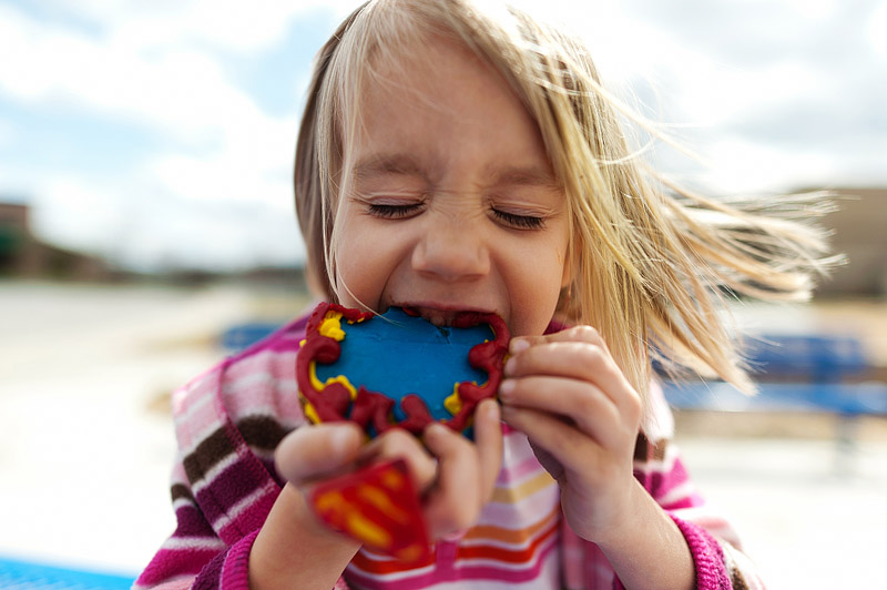 4 year old eating a cookie.