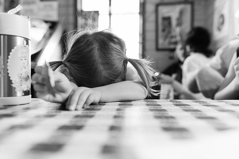 Toddler resting in a restaurant.