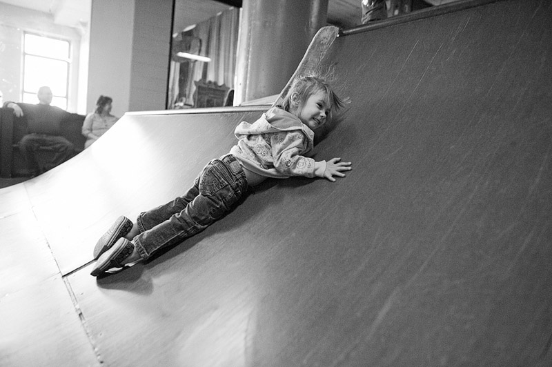 Toddler sliding down skate ramp at City Museum.