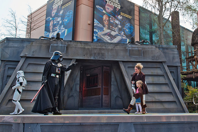 Darth Vader points at girl during Jedi training.