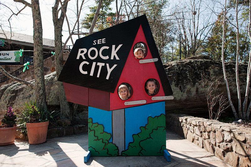 Kids posing in a 'See Rock City' barn photo prop.