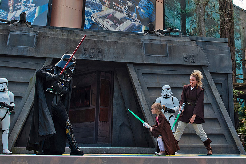 Girl fights Darth Vader.