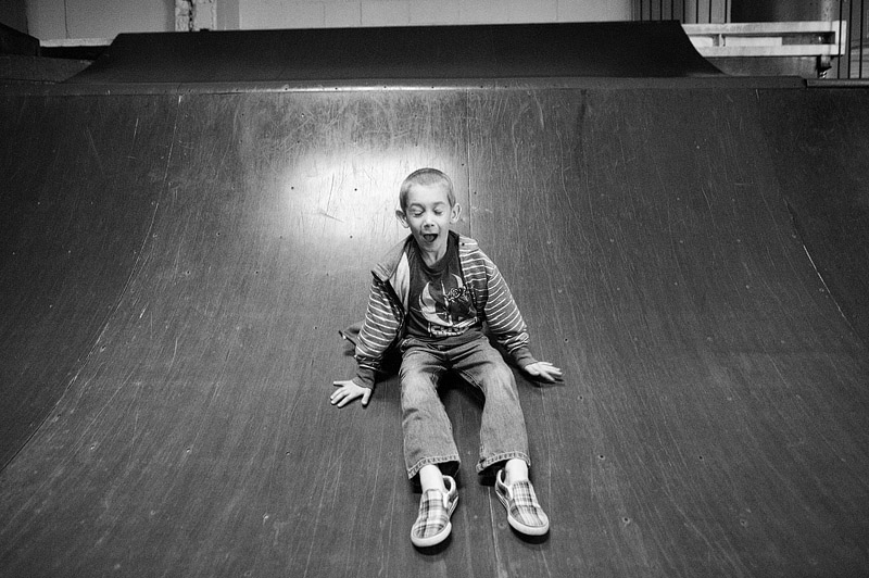 Boy sliding down skate ramp St. Louis Missouri.