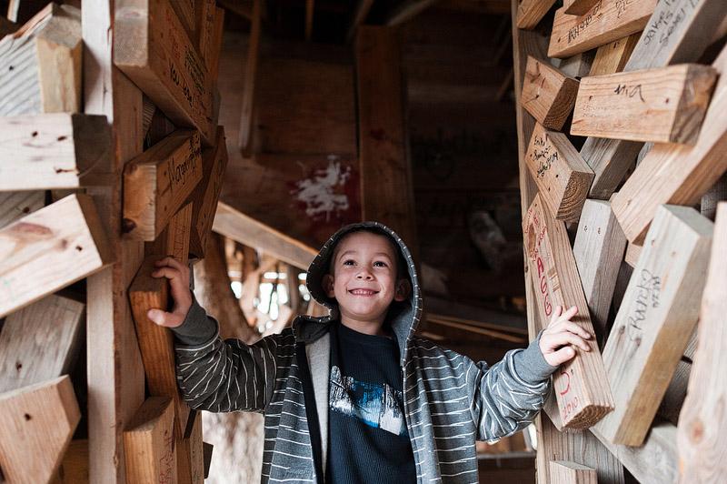 Boy smiling in the tree house in Crossville TN.