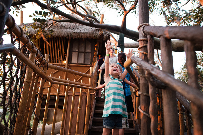Girl playing in the Swiss Family Robinson tree house.