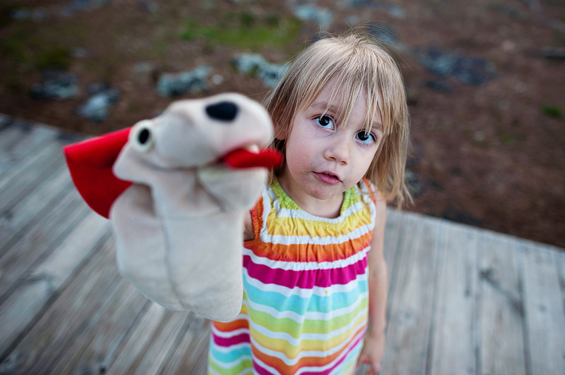Girl with dog puppet.