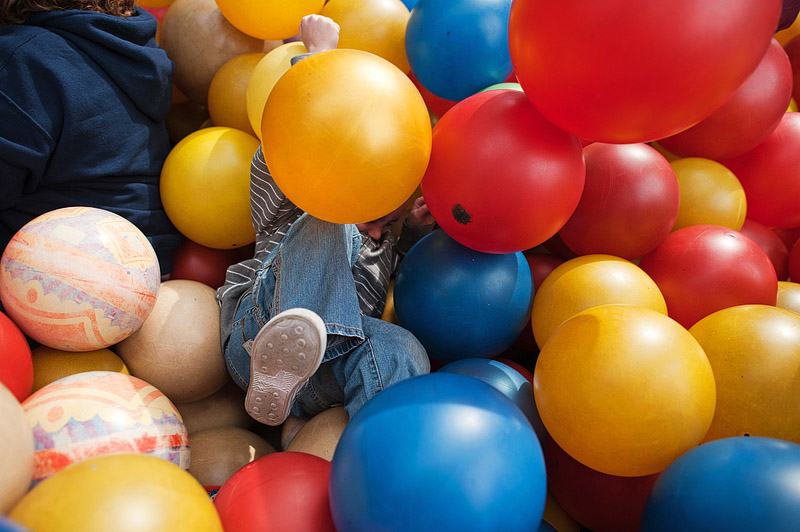 Boy having fun at the ball pit at City Museum.