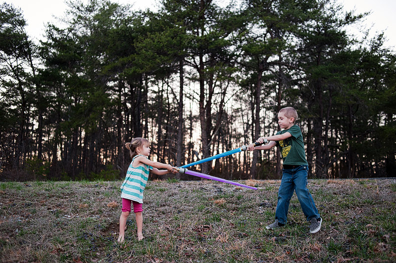 Kids lightsaber fighting at DeSoto State Park.