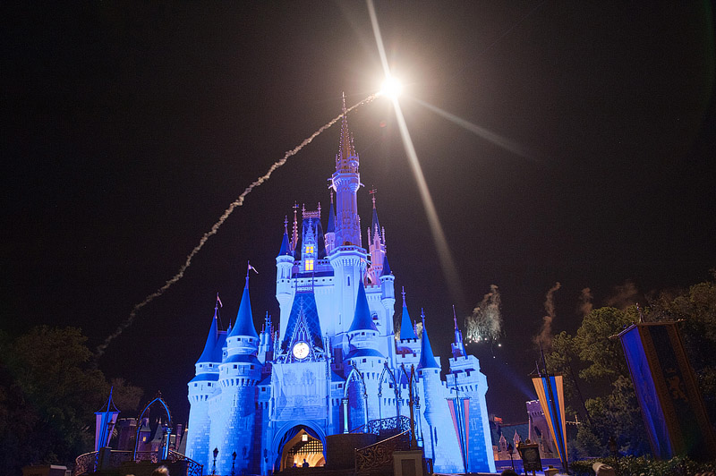 Shooting star over Cinderella's castle at Magic Kingdom.