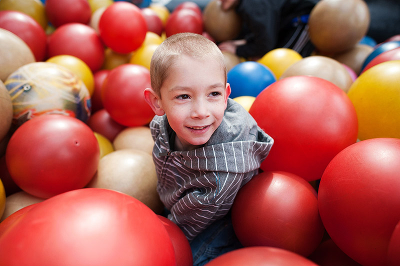 Boy playing in ball pit.
