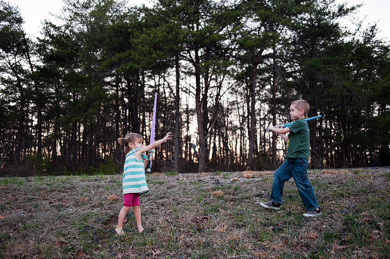 Toddler using The Force on her older brother.